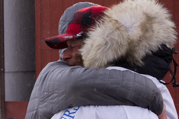 Martin was greeted by hugs galore from friends and family, handlers and his Nome hosts. KNOM Photo.
