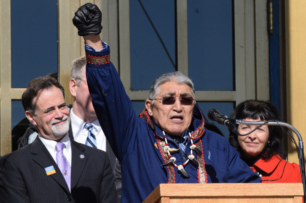 Rep. Benjamin Nageak raises his fist in solidarity with the effort to reduce domestic violence in Alaska at the Choose Respect rally on the Capitol steps, March 27, 2014. (Photo by Skip Gray/KTOO)