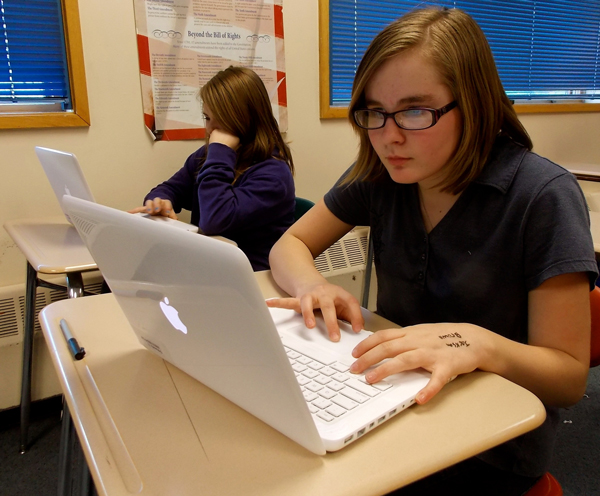 7th grade student, Madyson Sauer, works on her laptop in computer class. Photo by Angela Denning, KFSK - Petersburg.