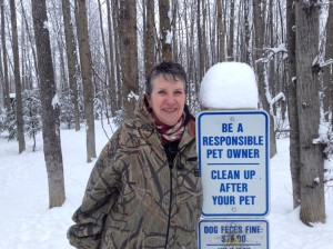 Cherie Norton poses near one of the posted warning signs.