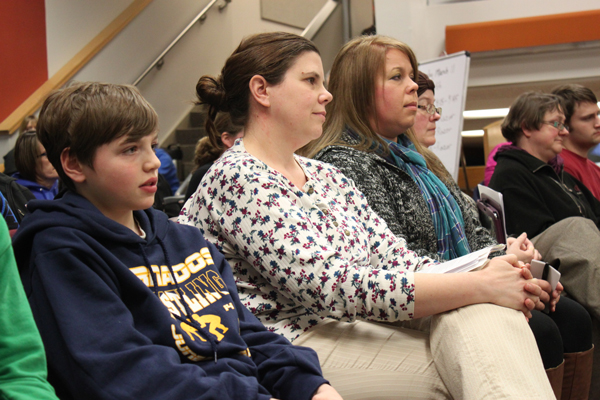 Dzantik'i Heeni Middle School student Connor Norman, his mother Michelle Norman, and school budget committee member Jennifer Lindley all testified during Tuesday night's school board meeting urging the board to reconsider the ban on middle school sports travel. (Photo by Lisa Phu/KTOO)