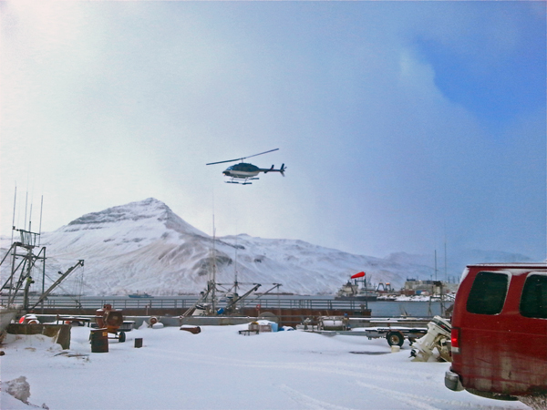 The new helicopter takes off from Akutan, bound for the airport on Akun Island. (Annie Ropeik/KUCB)