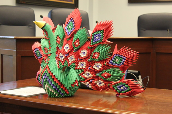 The origami peacock for peace is made of more than 2,000 pieces of paper. It's three feet wide and roughly two feet tall. (Photo by Lisa Phu, KTOO - Juneau)