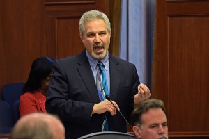 On the Alaska Senate floor, Sen. Pete Kelly addresses criticism of his interest in putting pregnancy tests in bars to reduce fetal alcohol syndrome, March 24, 2014. (Photo by Skip Gray/Gavel Alaska)