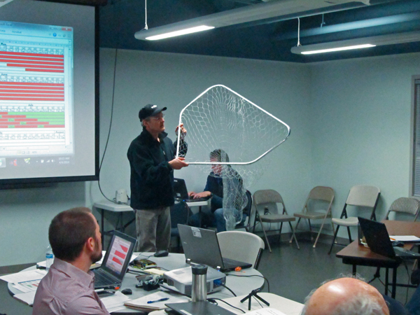 Working Group member Dave Cannon demonstrates dipnet features. (Photo by Ben Matheson, KYUK - Bethel)