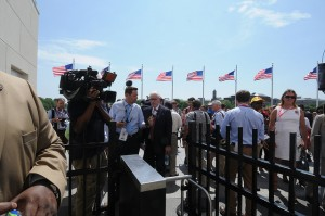 Rubenstein talks to news crews at the Washington Monument (Interior Department photo)