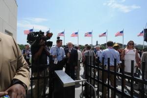 Rubenstein talks to news crews at the Washington Monument (Interior Department photo)