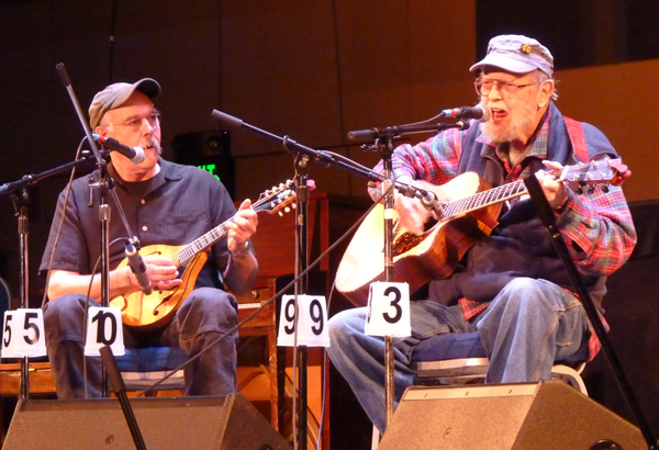 Pat Henry, right, and Bob Banghart, left, performing as We're Still Here. The two are the only musicians to have performed at all 40 festivals. (Photo by Ed Schoenfeld, CoastAlaska - Juneau)