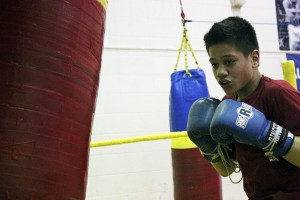 Arthur Tauilili practices punch combinations. (Photo by Josh Edge, APRN - Anchorage)