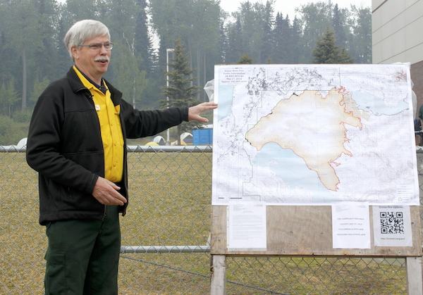 Public Information Officer Jim Schwarber briefs the media about the Funny Rover fire on Tuesday morning. (Photo by Josh Edge, APRN - Anchorage)