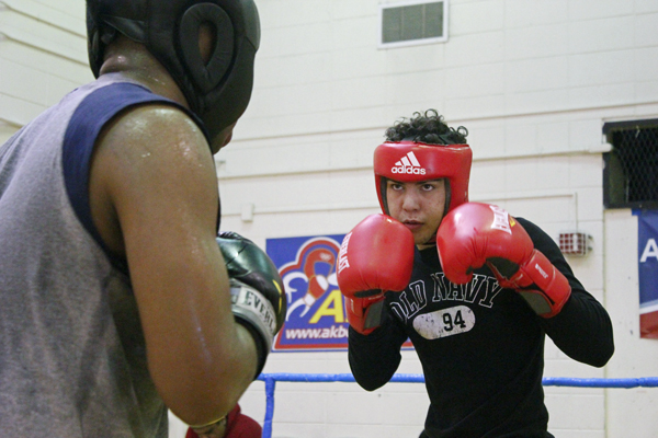 Nino Delgado spars with a partner at the Alaska Boxing Academy in April. (Photo by Josh Edge, APRN - Anchorage)