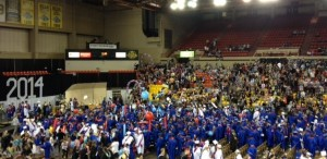 East High graduates celebrate after flipping their tassels.