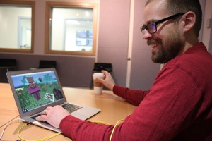 """UAS graduate student Colin Osterhout recreated the area of the """"Monster Lobe"""" inside Minecraft. He's also built Juneau and Douglas in the virtual world. (Photo by Lisa Phu/KTOO)"""