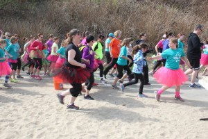 Every runner in Girls on the Run has a running buddy who stays with them for the entire 5K. (Photo by Lisa Phu/KTOO)