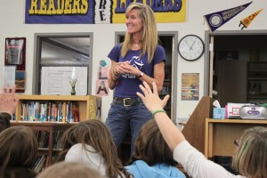Girls on the Run founder Molly Barker speaks to sixth grade girls at Floyd Dryden Middle School. (Photo by Lisa Phu/KTOO)