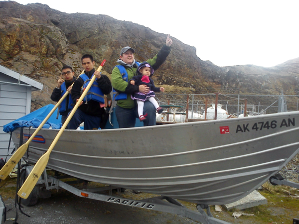Teammates JR Carpentero, Andy Nguyen, Emily Bruck and Lennyn, daughter of team member Alysha Richardson, pose on a boat for a scavenger hunt challenge. (Courtesy: Christian Escalante)
