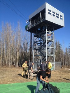 Smoke jumpers train to manage malfunctions on a zip line. (Photo by Emily Schwing, KUAC - Fairbanks)