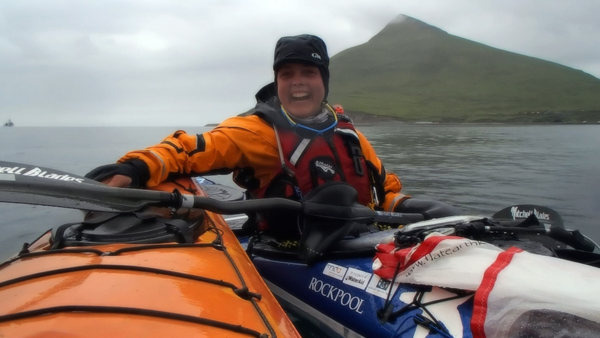 Sarah Outen sits in her kayak in Unalaska Bay on June 15, 2014. (Pipa Escalante/KUCB)