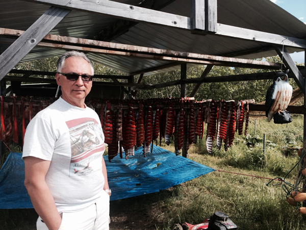 Arvin Dull, of Bethel, with his drying salmon at his fish camp in Oscarville Slough. (Photo by Daysha Eaton, KYUK - Bethel)