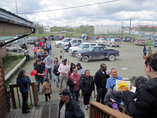Bethel residents line up to receive McDonald's cheesburgers from GCI. (KYUK photo)