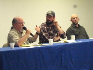 Biologists Brian McCaffery, Kevin Shaberg, and Aaron Poetter at a Yupiit Nation Fish Forum in Bethel. (Photo by Ben Matheson / KYUK)