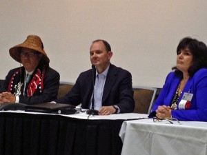 NCAI President Brian Cladoosby, middle, BIA undersecretary for Indian Affairs Kevin Washburn, middle, and NCAI executive director Jacqueline Pata, left. (Photo by Lori Townsend, APRN - Anchorage)