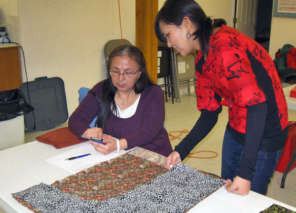 Michelle Konig Works on a Qaspeq with Annie Woods. (Photo by Daysha Eaton, KYUK - Bethel)
