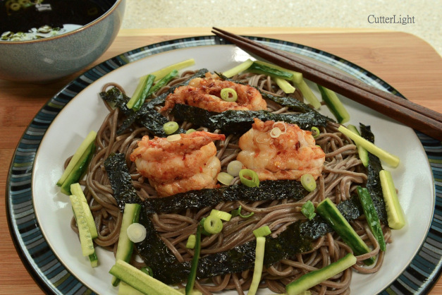 Zaru soba (Japanese buckwheat noodles) topped with Thai-seasoned Alaska spot prawns makes a perfect summertime meal.