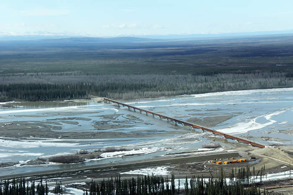 The contractor working on the Alaska Railroad's Tanana River bridge at Salcha has nearly completed work on the structure, shown here in an earlier stage of construction. It's the first phase of a larger project to extend the railroad to the Delta Junction area. (Credit Alaska Railroad)