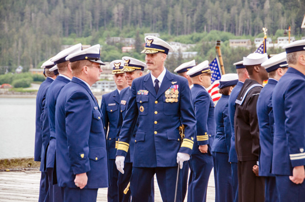 Rear Adm. Tom Ostebo inspects the District 17 crew with Rear Adm. Dan Abel. (Photo by Heather Bryant/KTOO)
