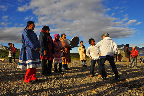 The residents of Novoye Chaplino greeted vistors when they arrived on the beach with traditional song and dance. (Emily Schwing KUAC)