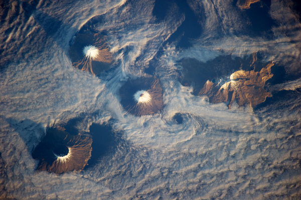 The Islands of the Four Mountains as seen from the International Space Station in 2013. Cleveland Volcano is at center. (Courtesy: NASA)