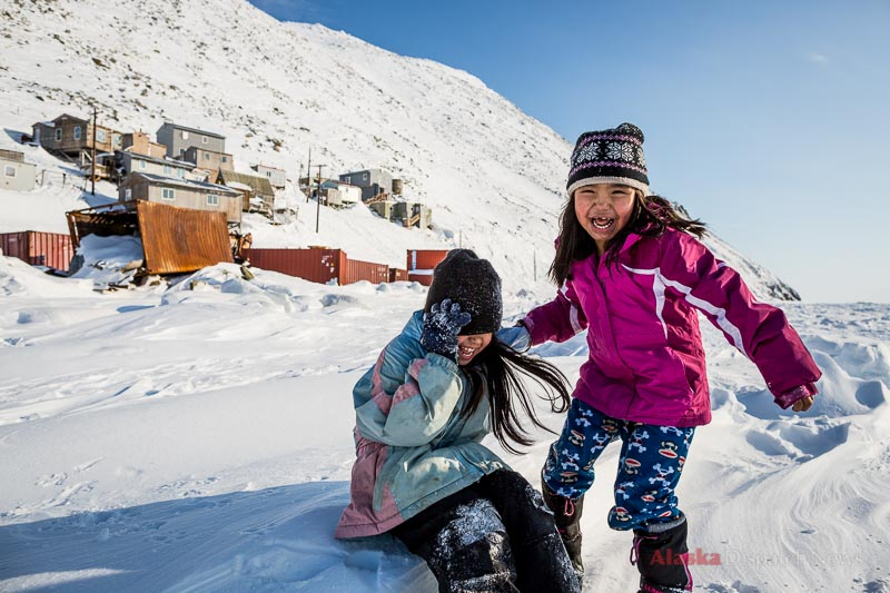 Children play on the sea ice in Diomede, Alaska on March 13, 2013. They can't stray too far from the village, lest they either meet a polar bear or cross the International Date Line, a mere 1 mile away.