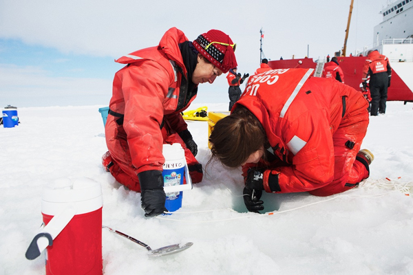 Researchers collect water samples in the Chukchi Sea. (Courtesy of Amanda Kowalski/ArcticSpring.org)