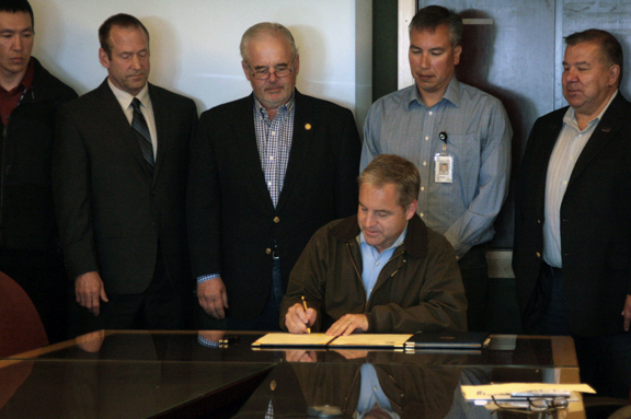 Governor Parnell signs HB 301, which eases the burdens on families for required autopsies. L to R: Alaska Medical Examiner Dr. Gary Zientek, Rep. Bob Herron, Governor Sean Parnell, YKHC President and CEO Dan Winkelman, and Senator Lyman Hoffman. (Photo by Dean Swope, KYUK - Bethel)
