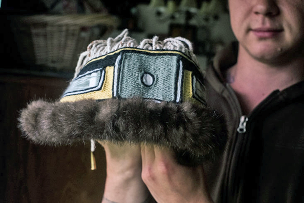 Ricky Tagaban holds a Chilkat headband he made. (Photo by Annie Bartholomew, KTOO - Juneau)