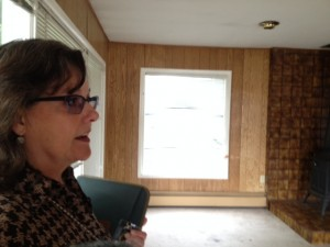 Jill Reese talks about the project inside one of the homes slated for removal. Hillman/KSKA