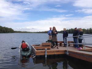 Project proponents speak as Ira Edwards tests out the new accessible dock on Jewel Lake.