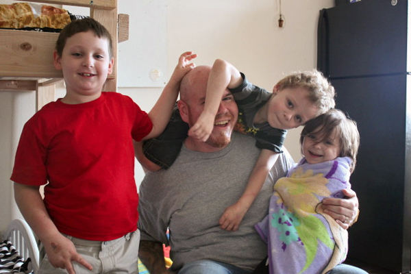 Corey MacDonald and his wife (not pictured) have three children – Miles, 7; Leland, 5; and Chloe, 4. (Photo by Lisa Phu/KTOO)