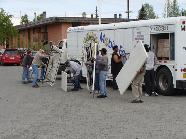 Volunteers set up for a Mobile Food Pantry in Anchorage.