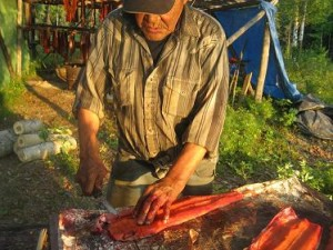 Cutting salmon for drying in Nikolai. Courtesy Alaska Department of Fish and Game.