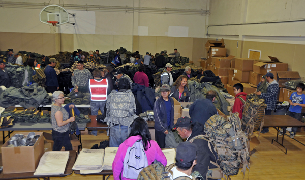 Veterans and family members pick out their gear from a wide selection. (Photo courtesy Samuel Hudson)