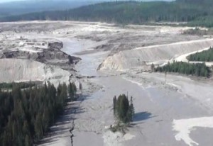 This aerial image from a British Columbia emergency office video shows the Mount Polley dam break and some of the damage downstream.