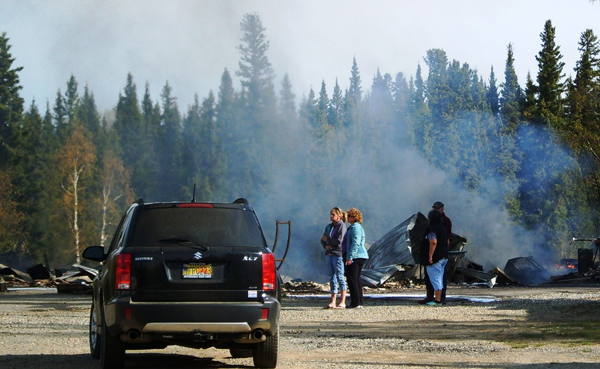 The 16-year-old that Troopers arrested and charged Monday with setting a fire at a Delta Junction house on Sunday also is charged with torching the Clearwater Lodge, shown here on the morning of May 15th. Credit KUAC file photo