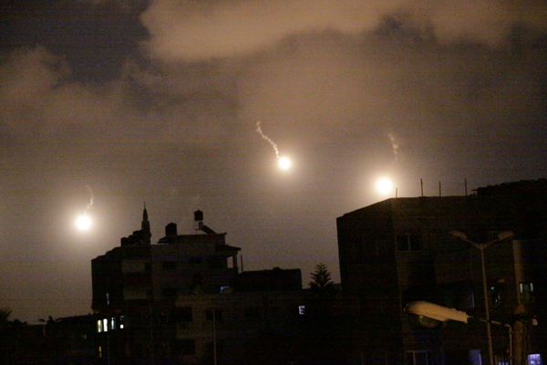 From his bedroom window, Haytham Mohanna took this photo of Israeli flares about a week ago. (Photo by Haytham Mohanna)