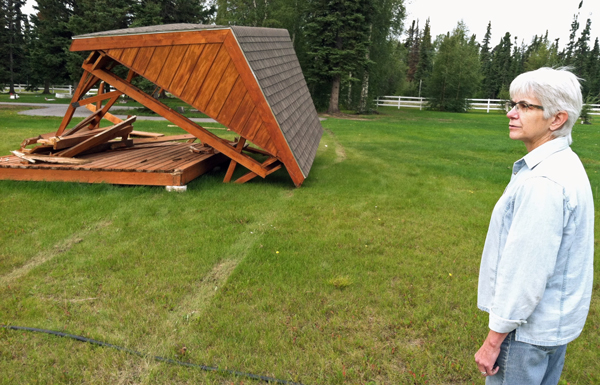 Delta Mayor Pro Tem Mary Leith examines the badly damaged gazebo in the Rest Haven Cemetery Sunday morning. (Photo by Tim Ellis, KUAC - Fairbanks)