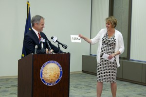 Alaska Governor Sean Parnell and Commissioner of Revenue Angela Rodell announce the amount of the 2014 Permanent Fund Dividend. (Photo by Josh Edge, APRN- Anchorage)