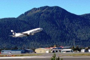 A southbound Alaska Airlines jet takes off from Petersburg's airport Sept. 13, 2014. Some of the airline's fares have been reduced and other price cuts may be coming. (Ed Schoenfeld, CoastAlaska News)