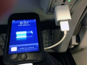 The new Alaska Alaska Airlines Recaro seats include plug-ins for phones, computers and similar devices. (Ed Schoenfeld, CoastAlaska News)