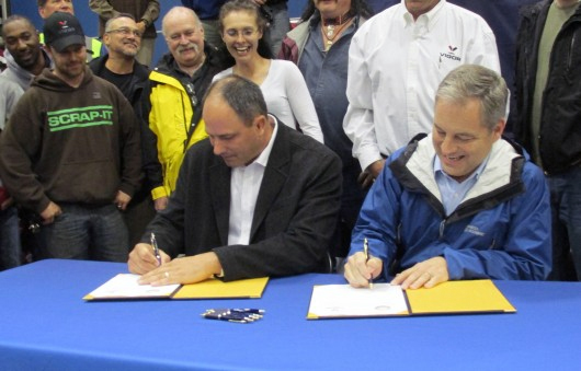 Adam Beck and Gov. Sean Parnell sign the contact for Vigor Alaska to build two new state ferries.